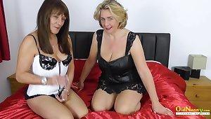 Super hot massage and lesbian masturbation of two milfs fingring