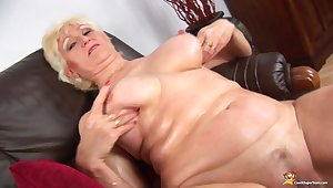 Oiled big natural breast dam in sexy nylon stockings filmed nude