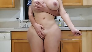 Scorching mother and sonny close by kitchen